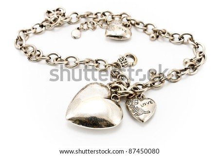 Silver necklace  with heart pendants isolated on white - stock photo