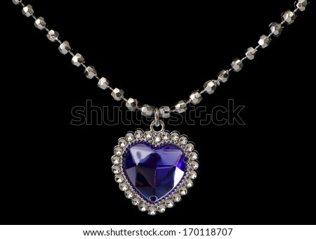 Silver pendant isolated on the black background - stock photo