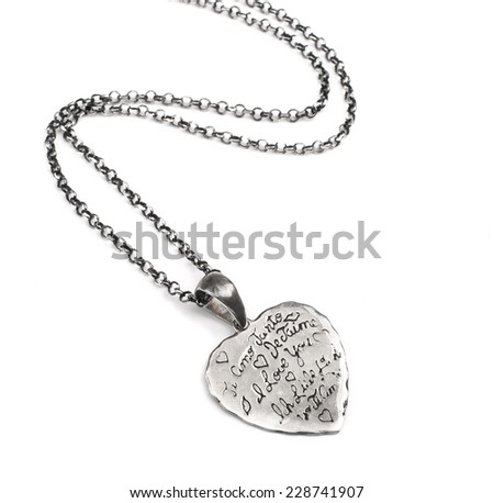 Silver pendant with carving - stock photo