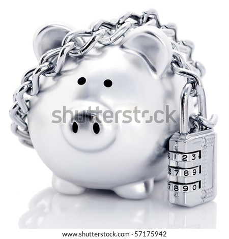 Silver piggy bank secured with padlock and chain, reflecting on white background. - stock photo