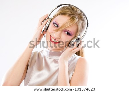 Silver pop girl, beautiful young blond girl with colorful makeup enjoying music in headphones. - stock photo