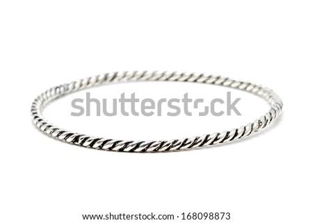 Silver slave bangle bracelet against a white background - stock photo