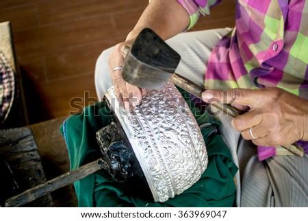 Silver smith working - stock photo