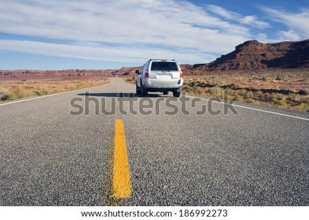 Silver SUV driving in Utah. - stock photo