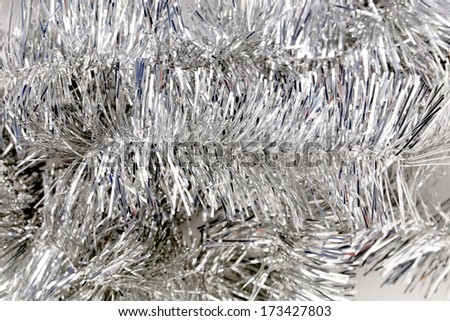 Silver tinsel. Christmas decoration. Close up. Whole background. - stock photo