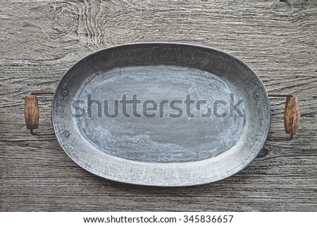 silver tray on wooden background - stock photo