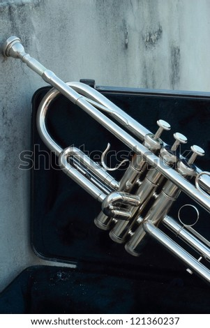 Silver trumpet in the black box - stock photo