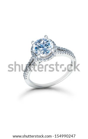 Silver Wedding or Engagement Ring with Blue Diamonds isolated on white background - stock photo