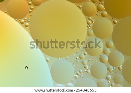 Silver, yellow and gold oil and water abstract - stock photo