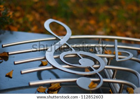 silvered clef on a staff - stock photo
