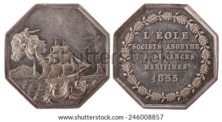 "Silvers token, Paris marine insurance company ""Eol"". France, Napoleon III, 1855, isolated on white - stock photo"