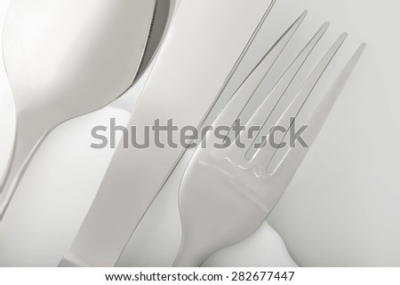 silverware fork, knife, spoon on white table - stock photo