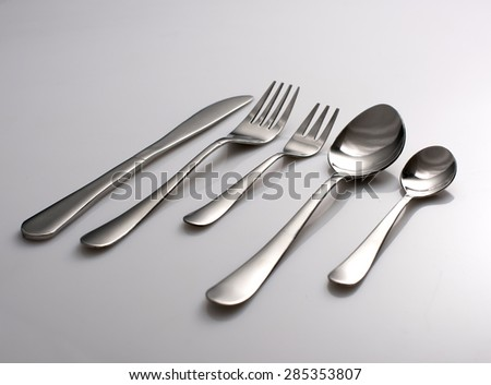 Silverware or flatware set of fork, spoons and knife - stock photo