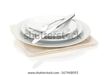 Silverware or flatware set of fork, spoons and knife on plates. Isolated on white background - stock photo