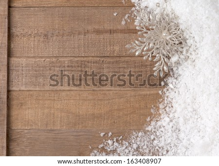 Silvery Christmas Snowflake Ornament in Snowbank on Rustic Wood background with Room or Space for Copy, Text, or your Words,  Horizontal  - stock photo