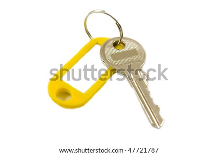 Silvery key from the house on white background - stock photo