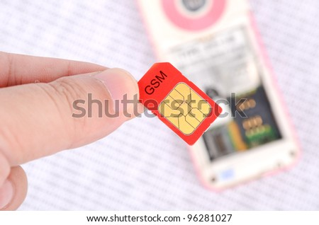 Sim card and cellphone on binary code - stock photo