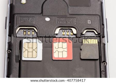 sim card and media micro sd card put on black smart phone nearly sim card slot and media slot - stock photo