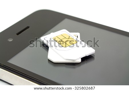 sim card and smart phone on white background - stock photo