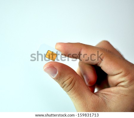 Sim card In a hand - stock photo
