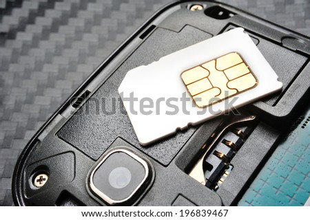 SIM card on the smart phone - stock photo