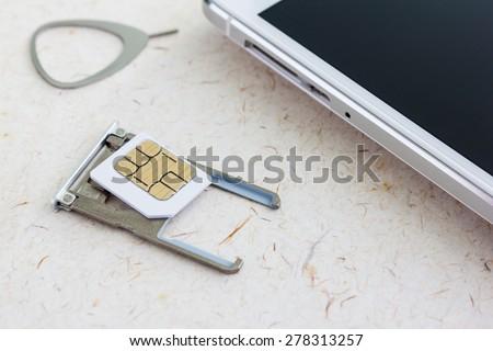 sim card sim tool and sim tray - stock photo