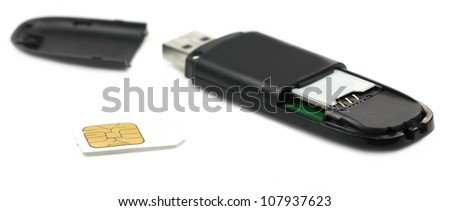 Sim card with GPRS Modem over white background - stock photo