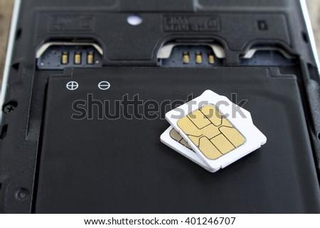 sim cards on smart phone, soft focused - stock photo