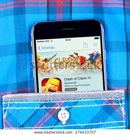 Simferopol, Russia - April 18, 2015: Apple iPhone 6 in the pocket displaying Clash of clans game application. Clash of Clans is a 2012 freemium mobile MMO strategy video game developed by Supercell - stock photo