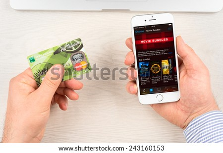 SIMFEROPOL, RUSSIA - JANUARY 10, 2015: iTunes application on Apple iPhone 6 display in movie bundles category. iTunes is a media player and media library, developed by Apple Inc. - stock photo