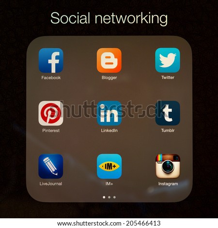 SIMFEROPOL, RUSSIA - JULY 17, 2014: Social networking applications on an Apple iPad Air retina display, which is designed by Apple Inc. Apple iPad Air official released of November 1, 2013. - stock photo