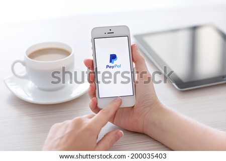 Simferopol, Russia - June 22, 2014: PayPal the largest operator of electronic money it was founded in 1998. PayPal most popular way of reception and sending Internet of payments at the eBay auction. - stock photo