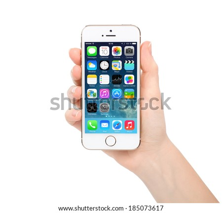 Simferopol, Russia- March 30, 2014: Apple Gold iPhone 5S displaying iOS 7.1 homescreen. iOS 7.1 mobile operating system designed by Apple Inc. official output 10 March 2014. - stock photo