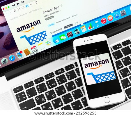 SIMFEROPOL, RUSSIA - NOVEMBER 22, 2014:  Amazon application on Apple iPhone 6 and Macbook display. Amazon is an American international electronic commerce company - stock photo