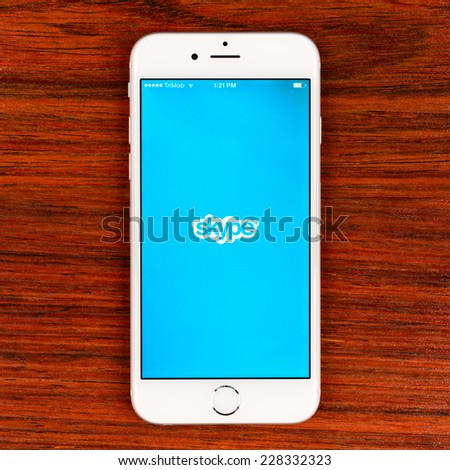 SIMFEROPOL, RUSSIA - NOVEMBER 03, 2014: Apple iPhone 6 displaying Skype application. Skype is a telecommunications application software that specializes in providing video chat and voice calls - stock photo