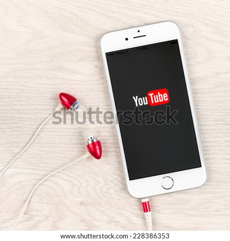 SIMFEROPOL, RUSSIA - NOVEMBER 03, 2014: Apple iPhone 6 plus displaying Youtube application. YouTube is the popular online video-sharing website, founded in February 14, 2005 - stock photo