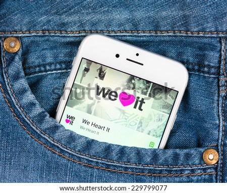 SIMFEROPOL, RUSSIA - NOVEMBER 11, 2014: Silver Apple iphone 6 in jeans pocket displaying We Heart It application. We Heart It is an image-based social network for inspiring images - stock photo