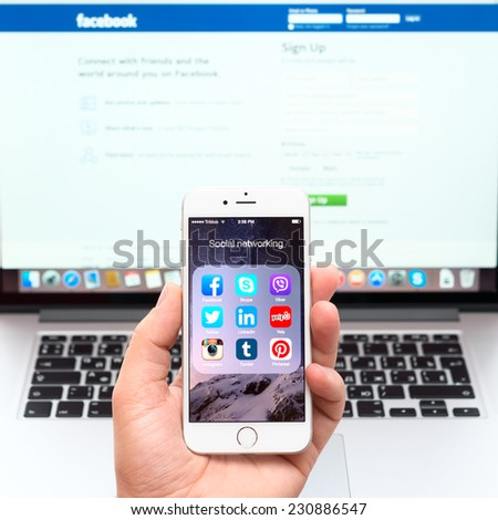 SIMFEROPOL, RUSSIA - NOVEMBER 16, 2014: Social networking applications on a Apple iPhone 6 display. The iPhone 6 and iPhone 6 Plus are smartphones running iOS developed by Apple Inc. - stock photo