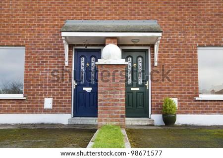 Similar but different entrance door to British/ Irish House - stock photo