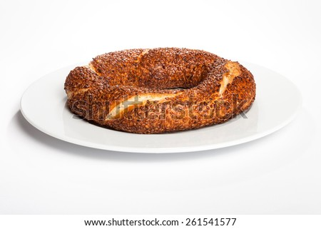 Simit (Turkish bagel) on white plate - stock photo