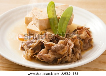 simmered beef and tofu - stock photo