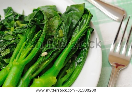 Simple and healthy stir fried Oriental green vegetables. - stock photo