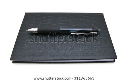 simple black hardcover book isolated on white background - stock photo
