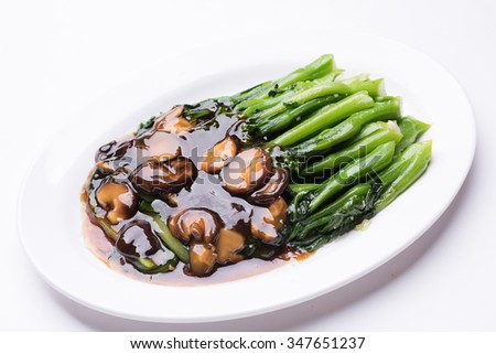 Simple but healthy stir fried Chinese style greens. - stock photo