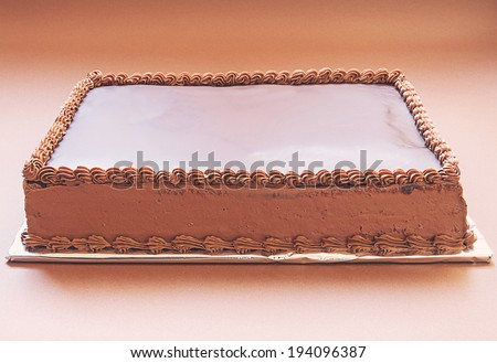 Simple chocolate cake on brown background.  - stock photo