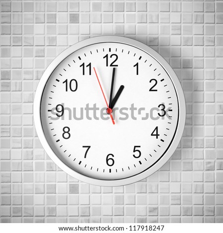 Simple clock or watch on white tile wall displaying one o'clock - stock photo