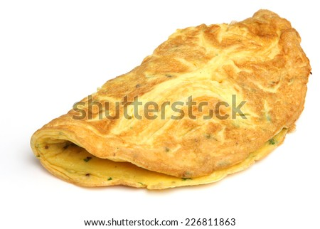 Simple egg omelette with herbs on white background. - stock photo