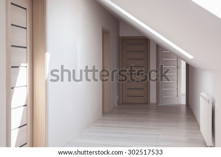 Simple home hallway design idea in neutral colors - stock photo