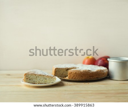 Simple homemade apple pie. A piece of apple pie with a cup of milk. - stock photo