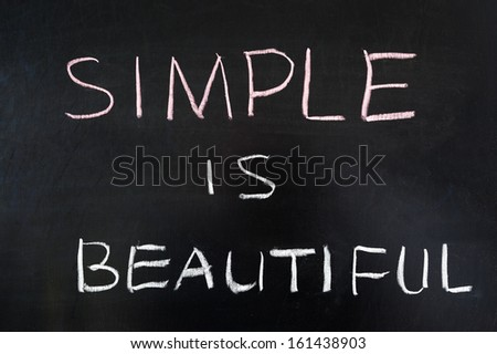 Simple is beautiful words written on blackboard - stock photo